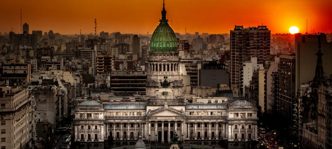 Sunset at the Palace of the National Congress of Argentina in Buenos Aires by By Miguel César (via Wikimedia Commons)